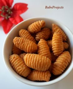 Kulkul (pronounced as Kalkal) is a sweet deep fried snack. It is prepared during Christmas. KulKuls are also known as Kidiyos. Goan Recipes, Indian Food Recipes, Sweet Recipes, Snack Recipes, Cooking Recipes, Milk Recipes, Cooking Tips, Kerala Recipes, Indian Desserts
