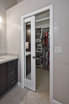 I like the idea of using pocket doors for the master closets as well.  Could use two smaller doors opening to either side.   How Mirrored Closet Doors Can Enhance The Beauty Of Your Home