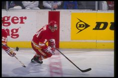 Rightwinger Theoren Fleury of the Calgary Flames moves down the ice during a game against the Buffalo Sabres at Memorial Auditorium in Buffalo New...
