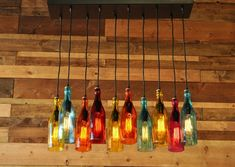 The Mardi Gras - Modern Recycled Bottle Chandelier With Colored Glass Bottles And Steel Canopy With Customizable Finish Colored Glass Bottles, Recycled Glass Bottles, Lighted Wine Bottles, Bottle Lights, Cut Bottles, Liquor Bottles, Modern Chandelier, Chandelier Lighting, Modern Lighting