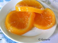 """Glyko Portokali (orange fruit preserve) is one of the most popular Greek preserves. The traditional way of making """"glyko portokali"""", is by using the peels making them into rolls whereas this one uses the whole fruit."""