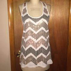 "SALE Almost Famous Ivory Tank w Sequins Sz L Almost Famous Ivory stretchy tank with gold sequins- size large. Made in China. In excellent condition.  Measurements: Chest: 18"", Waist: 17"", Total Length: 28"". Almost Famous Tops Tank Tops"