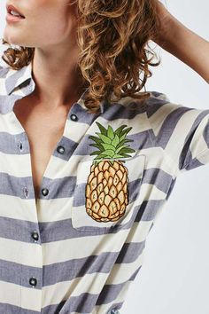A simple fitted shirt is a wardrobe staple - update the classic with cute embroidered details for the new season. With a crisp collar, and button down placket to the front this style comes detailed with a super-cute embroidered pineapple to the chest. Style back with boyfriend denim for a trending feel. #Topshop