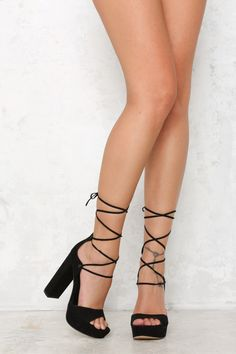 The Beyonc Heel has an open toe and a lace up ankle. It's made from a faux leather upper and sock, featuring a sartorially cool platform and chunky block heel. We love styling with a bodycon mini dress and a black velvet choker!  Heel. Non leather upper, lining and sole. Approx 3cm platform. Heel is approx 13cm. Size 8 is an EU38. This shoe runs true to size.