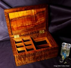 Hand-crafted Hawaiian curly koa wood ladies jewelry box. 7x10 inch interior. Half sliding top tray plus full removable bottom tray. www.SalterFineCutlery.com