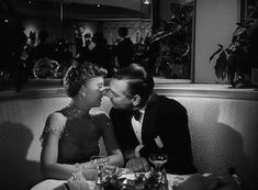Barbara Stanwyck and Clark Gable share a kiss in To Please A Lady (1950).