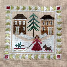 Dog Christmas Ornament Cross Stitch Patterns   Finished Cross Stitch Christmas Ornament Bringing by epicstitching