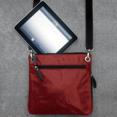 """On-the-Go Crossbody (by TRAY 6) (L 11"""" x W  2"""" x H 10.50"""") (2/2) - rain-resistant canvas exterior with satin lining, shoulder strap for easy transport, comfortably fits an iPad, multiple pockets to store your most necessary belongings (3 zipper pockets and 2 elastic pockets)."""