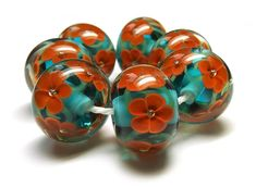 Lampwork glass 'Coquelicot' encased floral beads by Laura Sparling