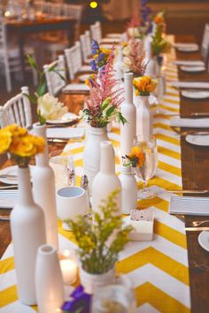 I love these white vases with colorful flowers...such a great #wedding idea! From http://stylemepretty.com/gallery/picture/924912  Photo Credit: http://staceybode.com/  Event Design by Bride and http://estoriasocial.com/