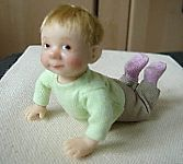 This cute doll is made by Catherine Muniere