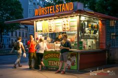 Sausage stand in where People meet to indulge in all varieties of Austrian Sausages Slow Travel, Vienna Austria, Sausages, Places To See, German, Drink, Eat, People, Food