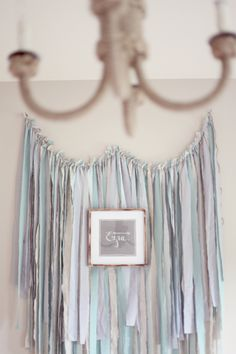 totally making this for above annie's bed. ribbons. love it!