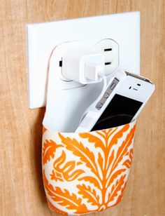 So your roommate doesn't accidentally step on your iPhone while it's charging.  Holder made out of an old lotion bottle