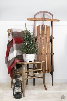 Woodland Christmas Home Tour. Love this corner vignette displaying a tree with an old sled. livelaughrowe.com