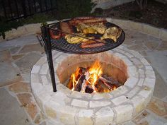 Fire pit with cooking grill. What a great idea!!!!!!   Just a picture to inspire