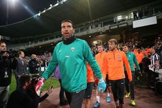 Gianluigi Buffon leads the Juventus players onto the pitch during a...