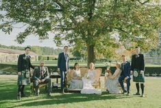 Sophisticated bridal party photography with Bride & Maids relaxing on a sofa under a tree canopy - Image by Modern Vintage Weddings - Lusan Mandongus wedding dress, Jenny Packham headpiece & Jimmy Choo shoes at a destination wedding in a Chateau in France with groom in a Reiss suit