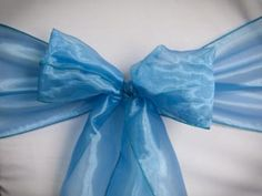 Chair Rentals- Blue Lagoon Organza Chair Sash. Complete the look with a matching table runner or napkin. Check out our other fabrics at Eventrentalutah.com or follow our board on Pinterest