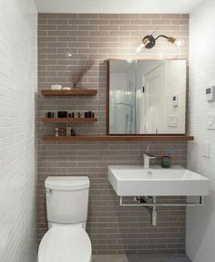 Shelves on wall behind toilet instead of built in for half bath with pedestal sink