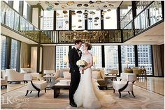 This classic wedding at the Langham Hotel mixed spring time with a Southern feel. Photos by Elena Bazini