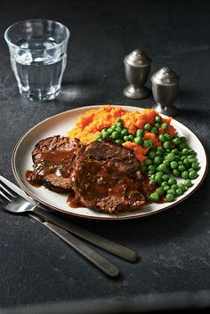 Weeknight entertaining is a breeze when you put your slow cooker to work! Adding a bit of flour to the sauce at the end of cooking turns it into a rich gravy to serve alongside the roast. Green peas and mashed sweet potatoes make great accompaniments to t
