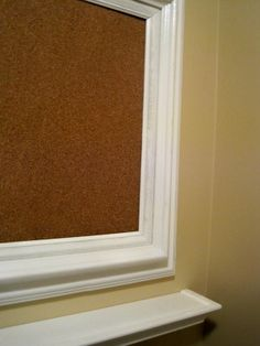 Replace glass in frame with cork board, perfect place to display kids art work.  Jessie's art nook in basement!  Spray paint all frames same color.