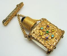 Vintage perfume bottle brooch from Mulberry Jones at Grays (showcase MB23).