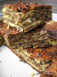 It looks a little unsuspecting once it has baked - like a modest chocolate chip cookie bar. But once you cut inside and see the thick, gooey layer of fudgy Bosnian Recipes, Croatian Recipes, Bosnian Food, Diet Recipes, Dessert Recipes, Cooking Recipes, Healthy Recipes, Burek Recipe, Kolaci I Torte