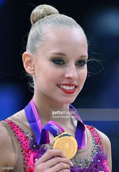 Olympic Makeup! Gold medal winner, Russia's Yana Kudryavtseva holds her trophy during an award ceremony of the ribbon final at the 31st Rhythmic Gymnastics European Championships in Minsk, on May 3, 2015.