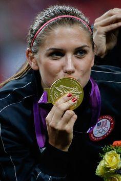 Alex Morgan wins gold as a member of the US women's soccer team.