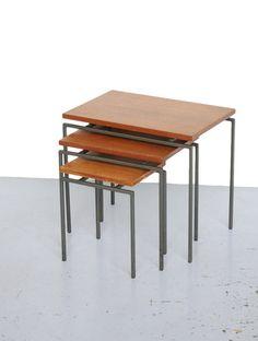 Cees Braakman; Teak and Enameled Metal Nesting Tables for Pastoe, 1950s.