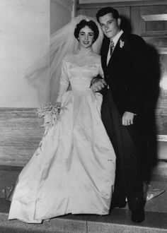 """Elizabeth Taylor was only 18 when she married Conrad """"Nicky"""" Hilton May 6, 1950. She wore a fifteen hundred dollar satin wedding gown."""