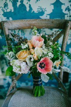lush mixed bouquet, photo by Emily Delamater http://ruffledblog.com/flanagan-farm-wedding #weddingbouquet #flowers #tulips