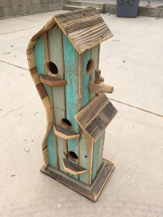 Love a turquoise birdhouse. love the shape and the antique wine spout!