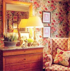 corner of floral bedroom with wing chair