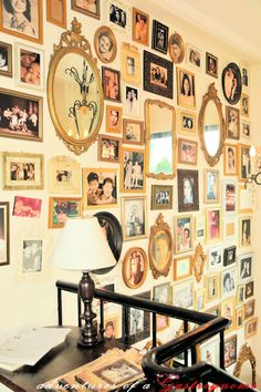 Tons of picture frames on the wall