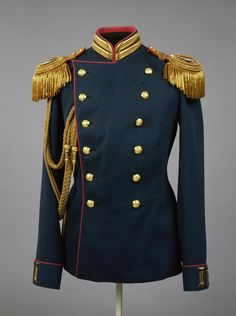Uniform of Emperor Nicholas II in the form of an officer of the Life Guards Rifle Regiment of the Imperial family Place of creation: Russia Date: 1903 School: St Petersburg Material: blue-green cloth, edging crimson shaped gold embroidery, buttons and gilded stamp
