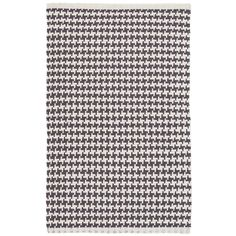 Checkmate! This woven cotton area rug, with a modern take on houndstooth in contrasting dark grey and ivory, is a winning design in any room.