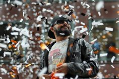 San Francisco Giants pitcher Sergio Romo acknowledges fans atop of a double deck bus during the San Francisco Giants World Series victory parade along Market Street in San Francisco, Calif., on Friday, Oct. 31, 2014. (Ray Chavez/Bay Area News Group)