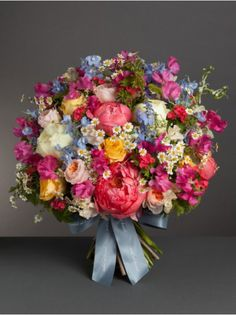Wild At Heart - Wild Meadow Bouquet - A vibrant and sumptuous mix of peonies, yellow roses, daisies, camomile, sweet peas and delphiniums. (Love the colors but way too much going on for a wedding bouquet! Bright Wedding Flowers, Beautiful Bouquet Of Flowers, Beautiful Flower Arrangements, Love Flowers, Floral Arrangements, Flowers Nature, Flowers Garden, Purple Flowers, Peony Bouquet Wedding