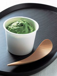 Matcha ice cream with a bamboo spoon made in Kyoto, Japan