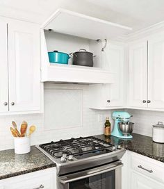 So clever! Faux slanted range hood is really a storage area! #RangeHoods