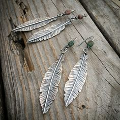 Sterling Feathers... Ocean Jasper Stone detailed ear wire in 'Natural' or 'Green' ~ feather is 2.5 inches long. Message me if you would like a pair & which pair. I won't get them online today. $115. #feathers #earrings #jewelry #joykruse #wildprairiesilver #artjewelry #feather #instasmithy