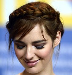 Super pretty braid crown and wispy bangs, and while we're at it, amazing eyeshadow, on Louise Bourgoin.