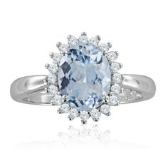 14k White Gold Halo Ring H, SI2, 1.68 cttw. .22ct Diamond and 1.46ct aquamarine ring features an oval natural aquamarine set in 14k white gold diamond halo ring. Aquamarine is March birthstone. $589.99 Perfect gemstone ring as an anniversary ring or engagement ring.