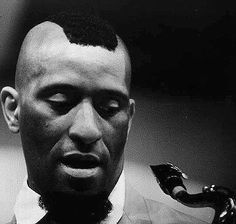 SONNY ROLLINS I made a coconut cake once for his birthday celebrated in a tiny place Da Flora's.  We all sang and folks played the piano.  Lars Mars did his version of LushLife.  Mr Rollins and his close friend Henry wore smoking jackets and wondered about all us hip cool youngster cats pawing at their knees