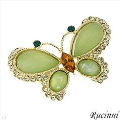$15.00  RUCINNI Irresistible Brand New Brooch With Crystals and Simulated gems Well Made in Yellow Base metal Length 23mm - Certificate Available.