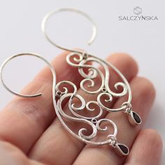 Forged hoop earrings with red garnets and sapphires in sterling silver