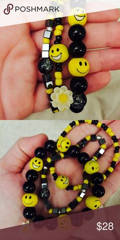 "90s Statement Stretchy Bracelet Set Handmade Set of three stretch bracelets with Glass Beads in high gloss black with bright wood painted smiley faces with different expressions. Unique glass cube beads with plastic daisy accent Bead and two cosmic clear and black glass beads.   Handmade by me. High quality product. Adult size.  One set available. One of a kind!  Comment ""gift wrap"" for free gift wrap after purchase! Jewelry Bracelets"